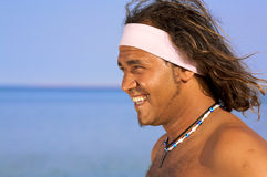 Smiling man on the beach Royalty Free Stock Photography