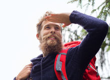 Smiling man with beard and backpack hiking Royalty Free Stock Images