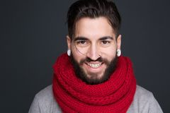 Smiling man with beard and red scarf Royalty Free Stock Photos