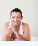 Smiling man in bed Stock Images