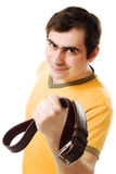 Smiling man with belt Stock Images