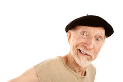 Smiling Man in Beret. Senior man with smirk and ragged shirt Stock Photo