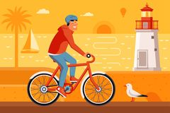 Man Riding Bicycle on Summer Beach. Smiling man on bicycle driving on summer beach background. Cyclist guy riding red bike on the sea side road. Summer bike Royalty Free Stock Photography