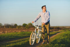 Smiling Man with Bicycle Royalty Free Stock Images