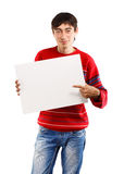 Smiling man with big card Royalty Free Stock Image