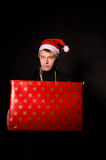 Smiling man with big present for christmas Royalty Free Stock Image