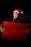 Smiling man with big present for christmas Royalty Free Stock Photo