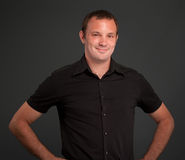 Smiling man in black. Portrait of a smiling man in a black shirt Stock Images