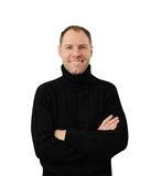Smiling man in black. Isolated on the white background Stock Image