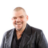 Smiling man in black leather jacket Stock Photography
