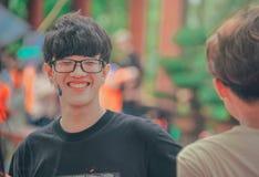 Smiling Man in Black Shirt Wearing Eyeglasses stock photography