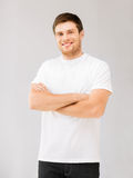 Smiling man in blank white t-shirt Royalty Free Stock Photos