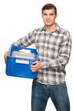 Smiling man with blue box Stock Images