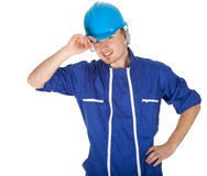 Smiling man in blue coveralls and helmet Stock Image