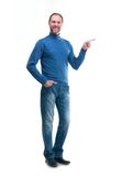 Smiling man in blue poloneck on a white background Royalty Free Stock Photos