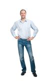 Smiling man in blue shirt and jeanse isolated on white backgroun Stock Photos