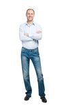 Smiling man in blue shirt and jeanse isolated on white backgroun Stock Images