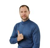 Smiling man in blue show thumb up isolated on the white Stock Images