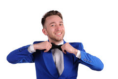Smiling man in blue suite on white background Royalty Free Stock Image