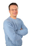 Smiling man in blue sweater an glasses Stock Photography