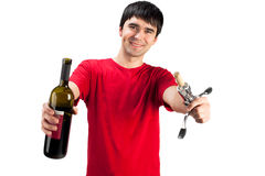 A smiling man with bottle of wine royalty free stock images