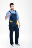 Smiling man builder in overall and cap pointing on you Stock Photos