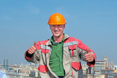 Smiling man builder show thumb up. Royalty Free Stock Photo