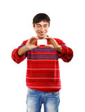Smiling man with business card. Smiling man in red striped sweater on white background with business card Royalty Free Stock Photos
