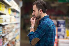 Smiling Man Buying Dairy Products In Supermarket. Handsome Young Man Shopping For Fruits And Vegetables In Produce Department Of A Grocery Store - Supermarket Royalty Free Stock Image