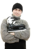 Smiling man in a cap with skates Stock Photo