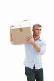 Smiling man carrying cardboard box Royalty Free Stock Photos