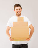 Smiling man carrying carton boxes Stock Photo