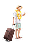 Smiling man carrying his luggage and giving thumb up Stock Image