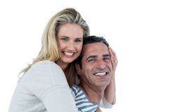 Smiling man carrying woman piggyback Stock Photo