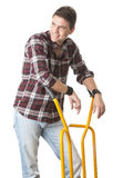 Smiling man with cart used for transport Stock Photo