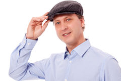 Smiling man in casual business outfit and hat isolated Royalty Free Stock Photo