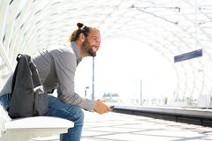 Smiling man with cell phone waiting at train platform. Portrait of smiling man with cell phone waiting at train platform Royalty Free Stock Images