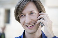 Smiling man with cellphone Stock Images
