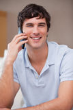 Smiling man on the cellphone Stock Image