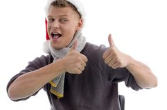 Smiling man with christmas hat showing thumbs up Stock Photography