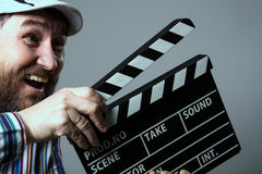 Smiling man with clapper movie Stock Image