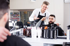 Smiling man client discussing his future haircut Royalty Free Stock Image