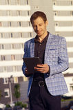 Smiling man with a clipboard in his hands royalty free stock photo