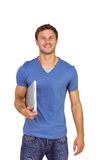 Smiling man with closed laptop Stock Images