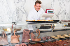 Smiling man cook cutting meat in butcher market Stock Photography