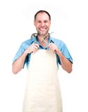 Smiling man cooking in apron isolated on white background Stock Image