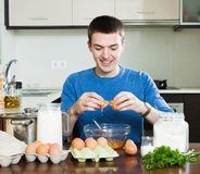 Smiling man cooking omlet Stock Image