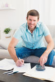Smiling man counting his bills Stock Images