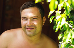 Smiling Man in country in summer day Royalty Free Stock Image