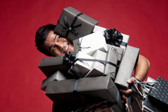 Smiling Man covered with presents Stock Photos